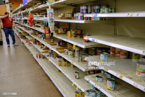 Shelves are cleared of canned food at a Kroger in Bloomington, just before the store shuts down for the night. A worker said they restock the shelves...