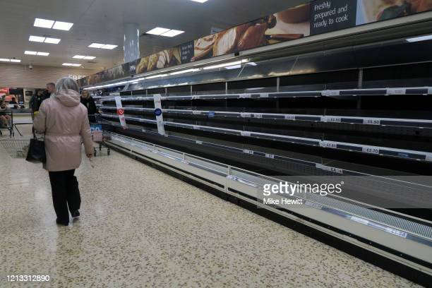 Shelves are empty as panic buying continues at the Tesco Holmbush store on March 18 2020 in Shoreham England
