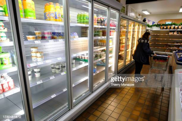 Shelves are empty in Stonemanor, a British grocery shop near Brussels, on January 8, 2021 in Kortenberg, Belgium. A member of staff stated that due...