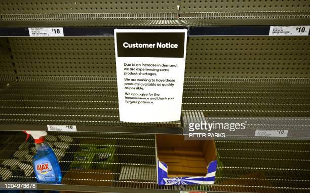 Shelves are empty of hand sanitiser in a supermarket in Sydney on March 4, 2020. - Australia's biggest supermarket announced a limit on hand...