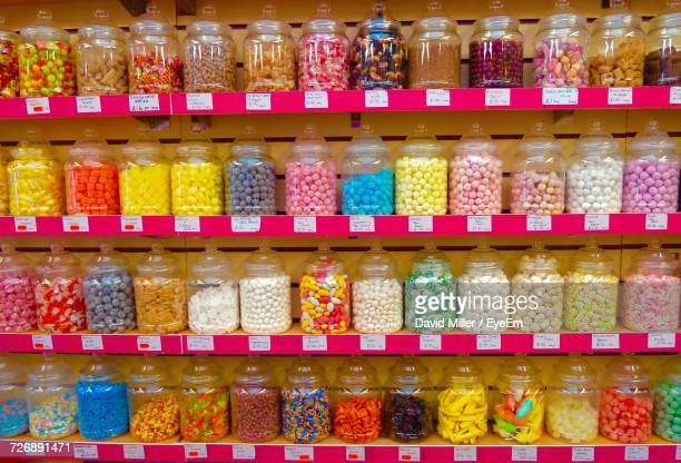 shelves at candy store - sweet shop stock pictures, royalty-free photos & images