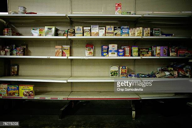 Shelves at the Capitol Area Food Bank are nearly empty after a full day of being picked over by aid agencies and food pantry workers December 5 2007...