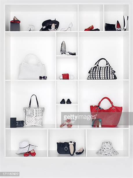 shelves filled with women's accessories - clutch bag stock pictures, royalty-free photos & images
