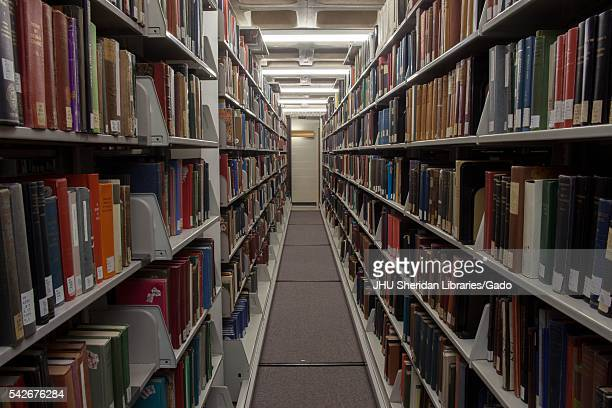 Shelves full of books on C-level, the lowest floor of the Milton S. Eisenhower Library on the Homewood campus of the Johns Hopkins University in...
