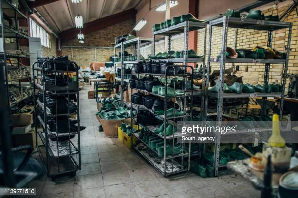 shelves full of shoes in shoe factory - shoe factory stock pictures, royalty-free photos & images