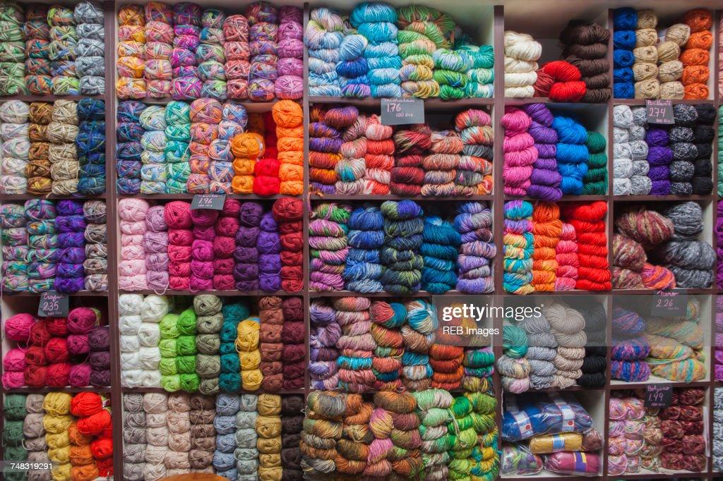 Shelves full of yarn at store : Stock Photo