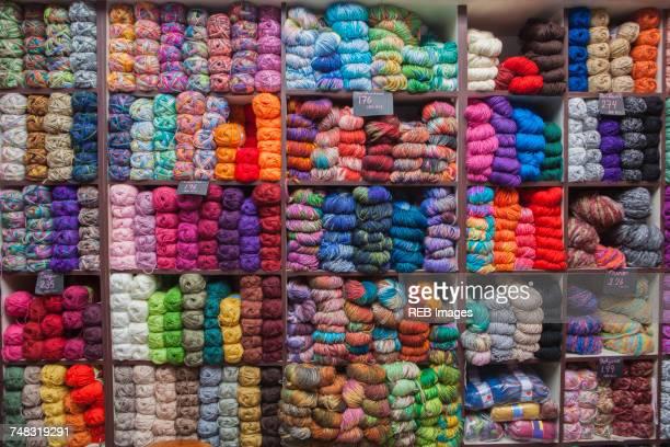 Shelves full of yarn at store
