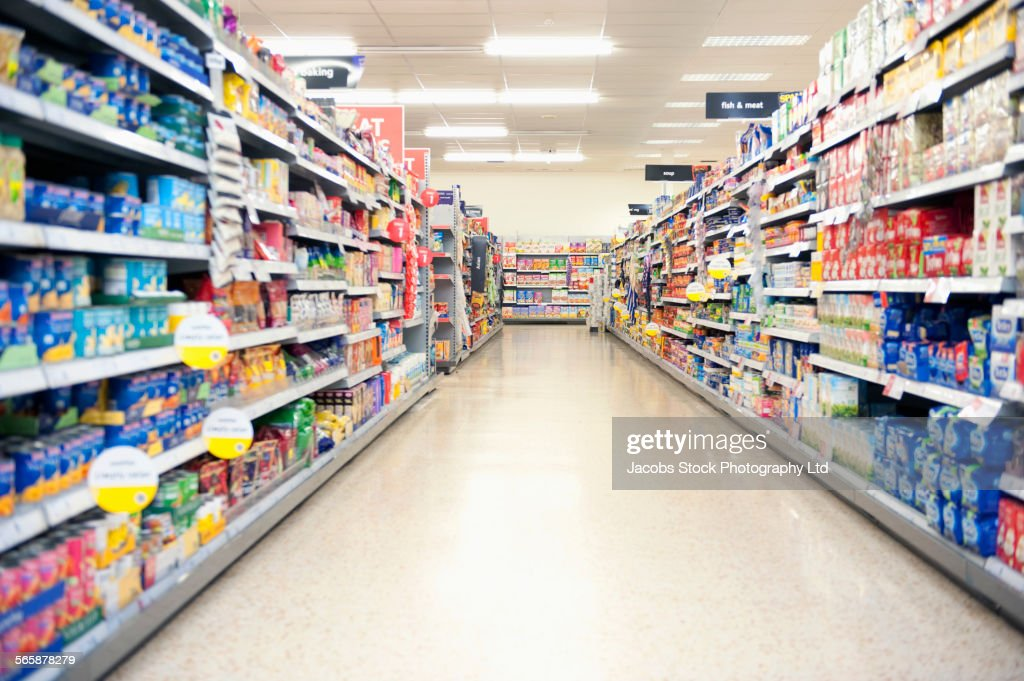 Shelves in grocery store aisle : Stock Photo