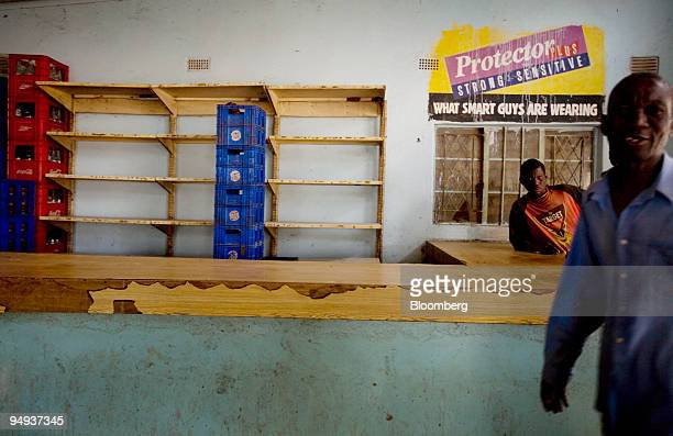 Shelves lie empty in a general store in Mazowe Zimbabwe on Wednesday April 22 2009 The South African rand is the reference currency being used in...