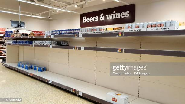 Shelves nearly empty of beer at a supermarket in Ashford Kent as shoppers purchase supplies amid the coronavirus pandemic