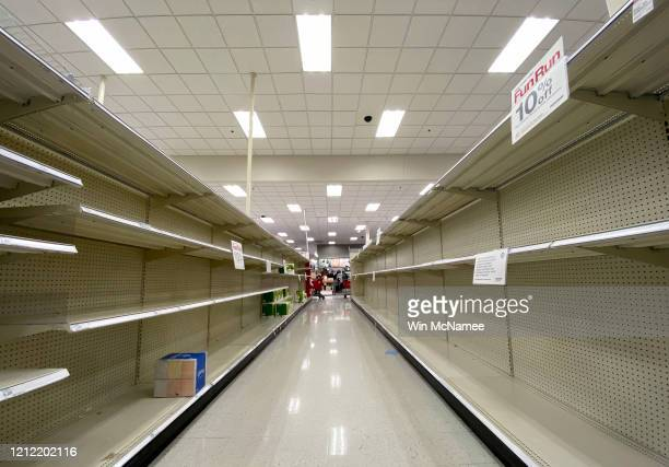 Shelves normally stocked with hand wipes hand sanitizer and toilet paper sit empty at a Target store as people stockpile supplies due to the outbreak...