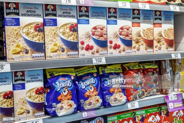 Shelves of cereals for sale inside Carrefour Express.