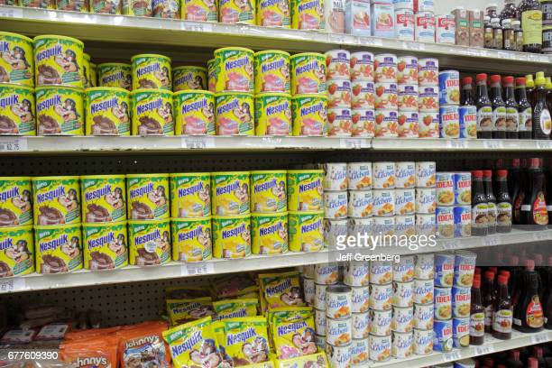 Shelves of chocolate milk powder for sale at La Colonia Supermarket