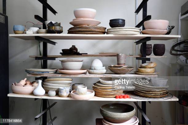 shelves of clay dishes in a ceramics studio - pottery stock pictures, royalty-free photos & images