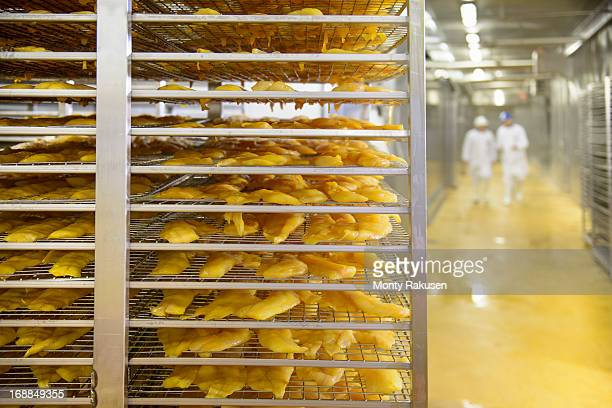 shelves of haddock fish ready for smoking in food factory - storage compartment stock pictures, royalty-free photos & images