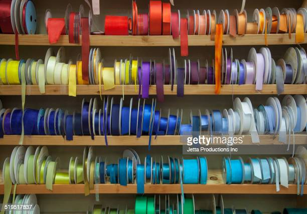 Shelves of multicolor ribbons on store shelf