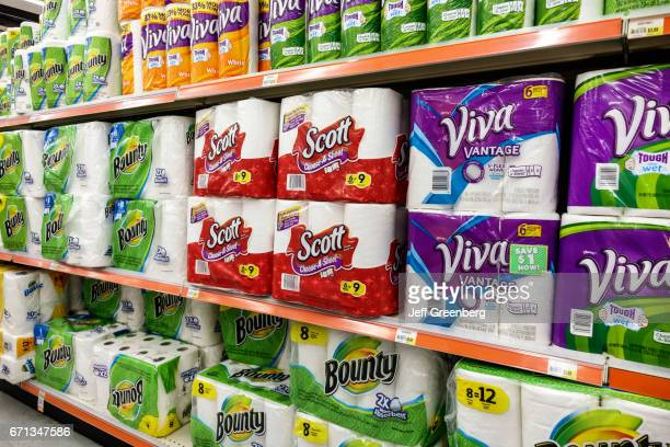 Shelves of paper towels for sale inside Navarro Discount Pharmacy.