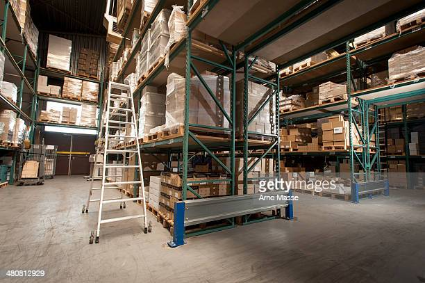 Shelves of stock and orders in printing warehouse