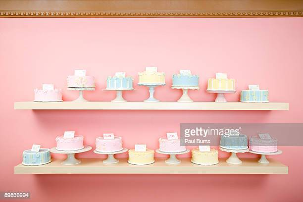 Shelves on Wall in Bakery With Colorful Cakes