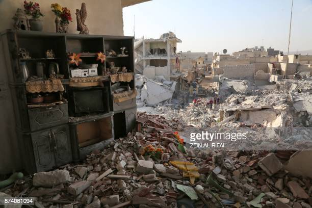 TOPSHOT Shelves remain standing amidst the rubble on November 14 2017 following an air strike the previous day on the northern rebelheld Syrian town...
