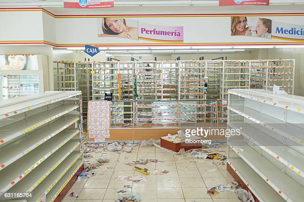 Shelves sit empty at the Guadalajara Pharmacy after looting in Veracruz City Mexico on Saturday Jan 7 2017 Mexico's National Association Of Retail...