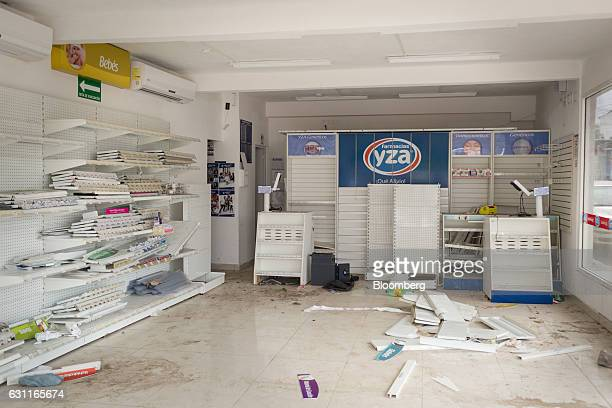 Shelves sit empty at the YZA Pharmacy after looting in Veracruz City Mexico on Saturday Jan 7 2017 Mexico's National Association Of Retail And...