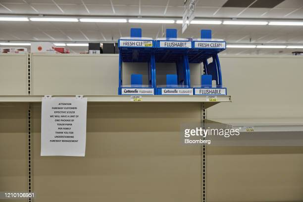 Shelves usually displaying toilet paper stand empty at a Fareway grocery store in Sioux Falls South Dakota US on Wednesday April 15 2020 South Dakota...