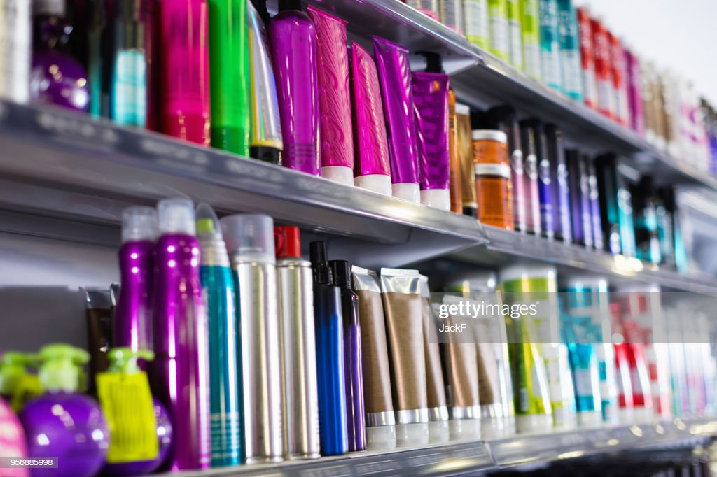 Shelves with hair care products in a cosmetics showroom indoor : Stock Photo