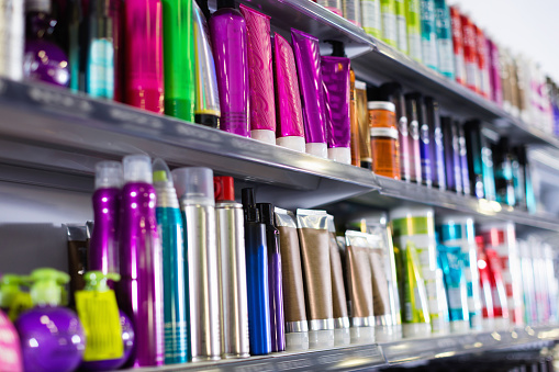 Shelves with hair care products in a cosmetics showroom indoor 956885998
