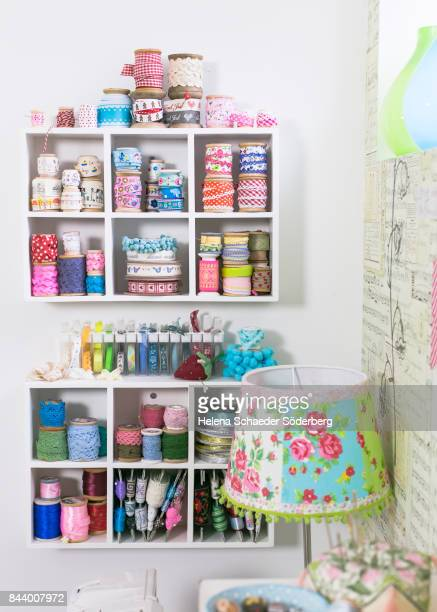 Shelves with large collection of ribbons and lace