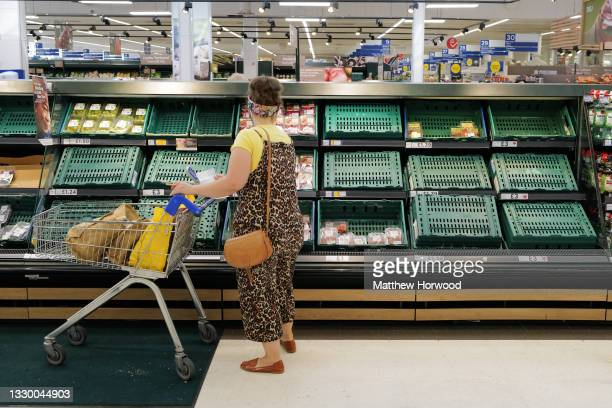 Shelves with low stock at a Tesco store on July 21, 2021 in Cardiff, United Kingdom. Supermarkets across the UK are emptying of fresh produce and...