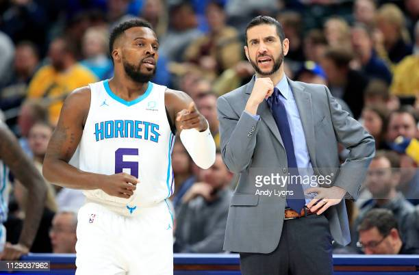 Shelvin Mack and James Borrego the head coach of the Charlotte Hornets talk during the game against the Indiana Pacers at Bankers Life Fieldhouse on...