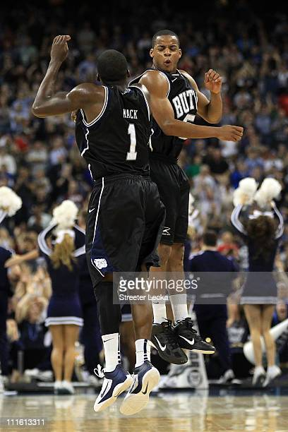 Shelvin Mack and Ronald Nored of the Butler Bulldogs celebrate after a shot to end the first half against the Connecticut Huskies during the National...