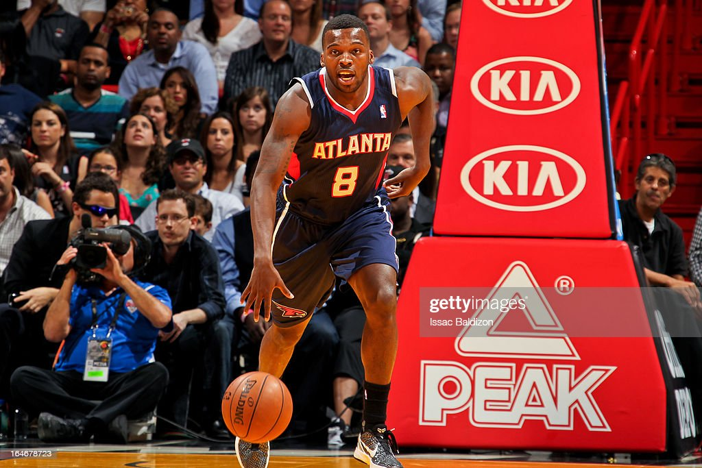 Shelvin Mack #8 of the Atlanta Hawks advances the ball against the Miami Heat on March 12, 2013 at American Airlines Arena in Miami, Florida.