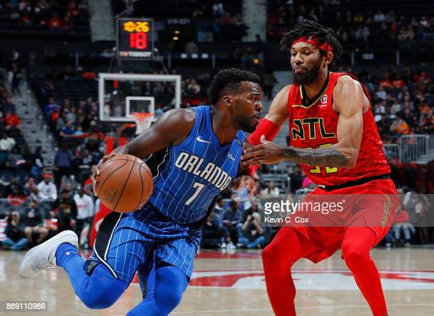 Shelvin Mack of the Orlando Magic drives against DeAndre' Bembry of the Atlanta Hawks at Philips Arena on December 9 2017 in Atlanta Georgia NOTE TO...