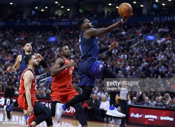 Shelvin Mack of the Orlando Magic shoots the ball as Fred VanVleet and Serge Ibaka of the Toronto Raptors defend during the first half of an NBA game...