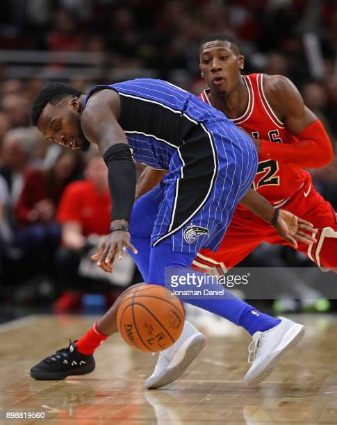 Shelvin Mack of the Orlando Magic turns to a loose ball under pressure from Kris Dunn of the Chicago Bulls at the United Center on December 20 2017...