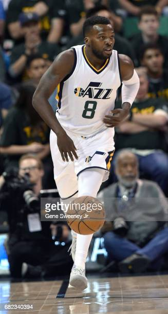 Shelvin Mack of the Utah Jazz brings the ball up court against the Golden State Warriors in Game Four of the Western Conference Semifinals during the...