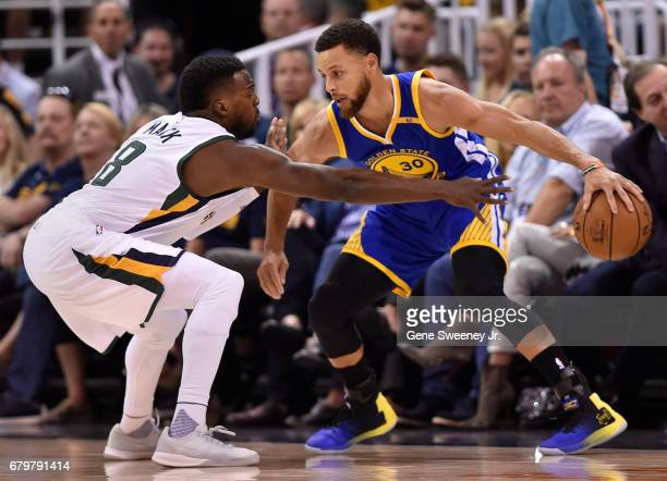 Shelvin Mack of the Utah Jazz defends against Stephen Curry of the Golden State Warriors in the first half in Game Three of the Western Conference...