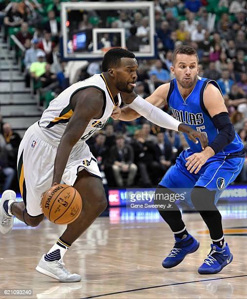 Shelvin Mack of the Utah Jazz drives past the defense of JJ Barea of the Dallas Mavericks during their game at Vivint Smart Home Arena on November 2...