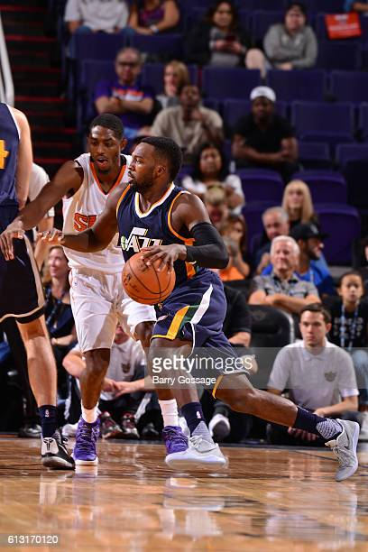 Shelvin Mack of the Utah Jazz drives to the basket during a preseason game against the Phoenix Suns on October 5 at Talking Stick Resort Arena in...