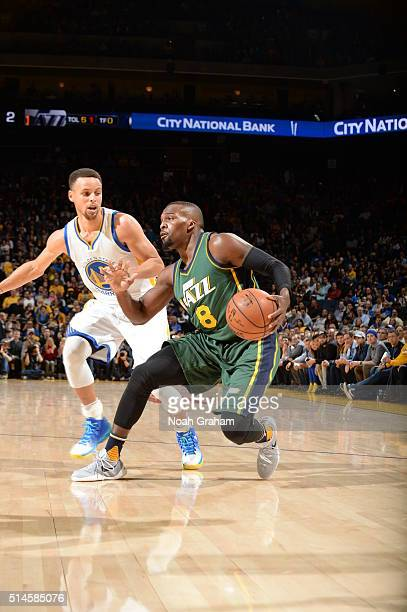 Shelvin Mack of the Utah Jazz handles the ball against Stephen Curry of the Golden State Warriors on March 9 2016 at Oracle Arena in Oakland...