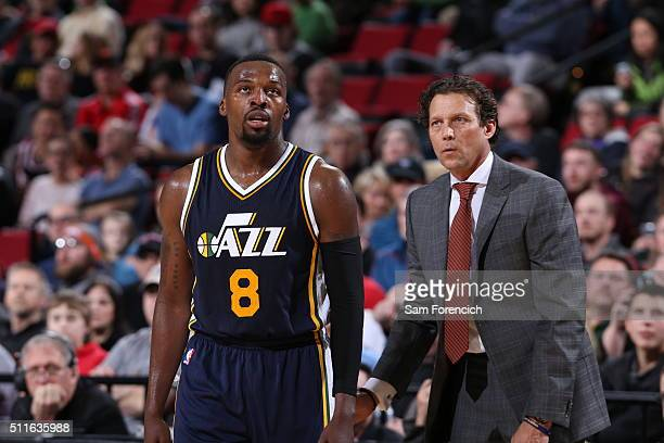 Shelvin Mack of the Utah Jazz talks with lHead Coach Quin Snyder of the Utah Jazz during the game against the Portland Trail Blazers on February 21...