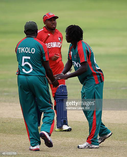 Shem Ngoche of Kenya is congratulated by Steve Tikolo after bowling Dion Stovell of Bermuda during the ICC World Twenty20 Qualifier match between...
