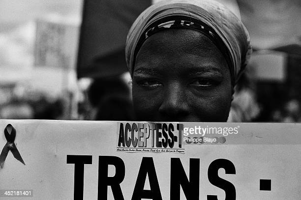 Shemale shows a banner about transexual rights during the Gay Pride in Paris, 2013. Black and White.