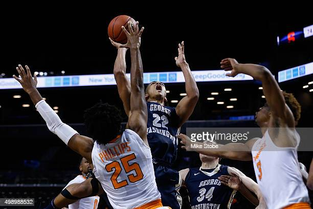 Shembari Phillips of the Tennessee Volunteers defends against Joe McDonald of the George Washington Colonials at Barclays Center on November 27 2015...