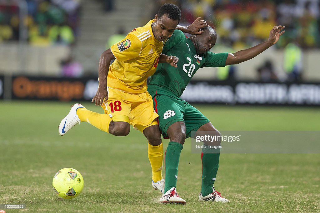 Shemeles Bekele Godo of Ethiopia (L) challenges Wilfried Leon Bakary Sanou of Burkina Faso during the 2013 African Cup of Nations match between Burkina Faso and Ethiopia from Mbombela Stadium on January 25, 2013 in Nelspruit, South Africa.
