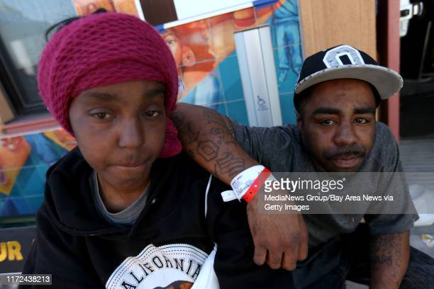 Shemia Bishop and husband Bobby Bishop pose for a photograph outside the temporary American Red Cross shelter setup at the West Oakland Youth Center...