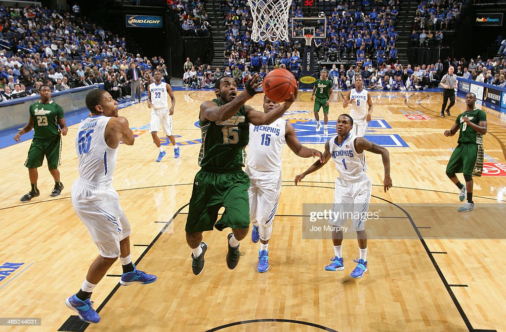 Shemiye McLendon #15 of the USF Bulls drives to the basket for a layup against the Memphis Tigers on January 26, 2014 at FedExForum in Memphis, Tennessee. Memphis beat South Florida 80-58.