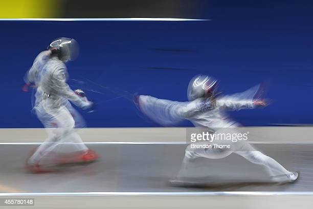 Shen Chen of China and Kim Jiyeon of South Korea compete in the Women's Sabre Semi Final during day one of the 2014 Asian Games at Goyang Gymnasium...